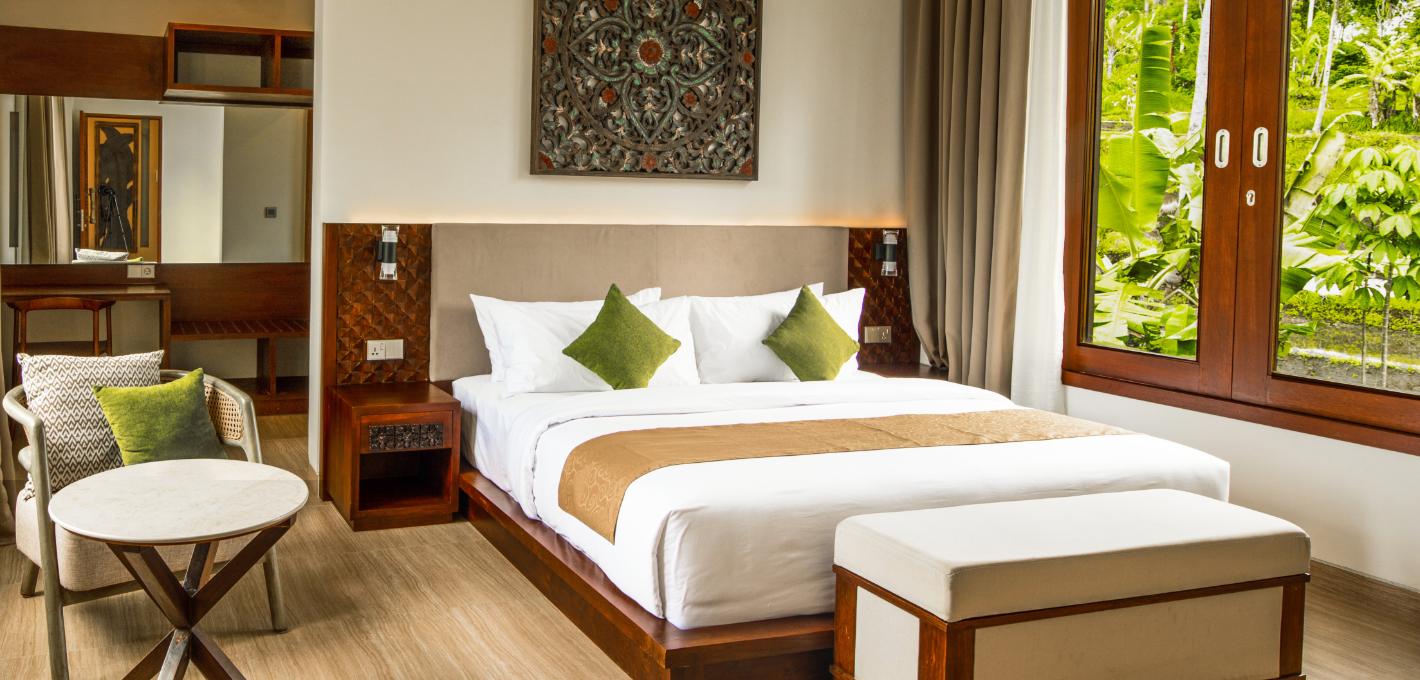 A lavish king-size bed | 3 Bedroom Pool Villa Stanagiri Retreat Ubud Bali